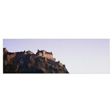 Low angle view of a castle on top of a hill, Edinb Poster