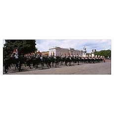 British royal guards horseback riding in front of  Poster