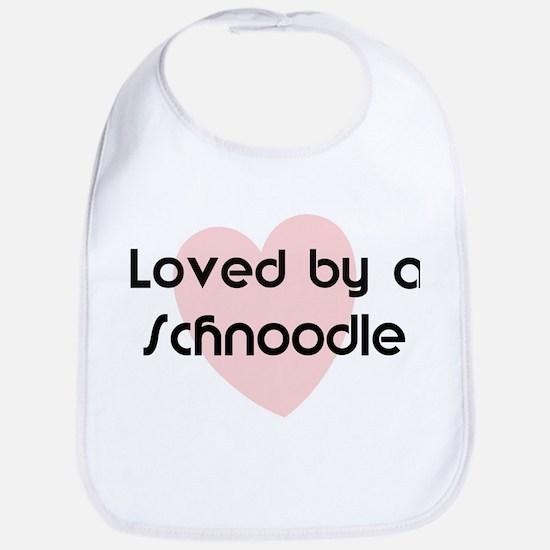 Loved by a Schnoodle Bib