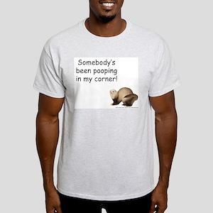 ferret-pooping-in-corner T-Shirt