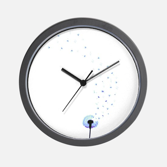 Dandelion seeds blowing in the wind Wall Clock
