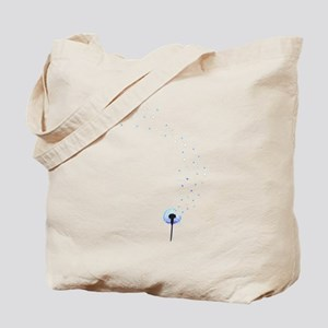 Dandelion seeds blowing in the wind Tote Bag