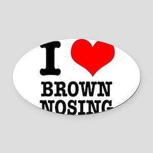 BROWN NOSING Oval Car Magnet