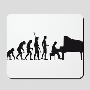 evolution piano player Mousepad