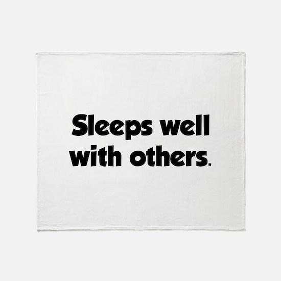 Sleeps well with others Throw Blanket