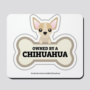 Owned by a Chihuahua Mousepad