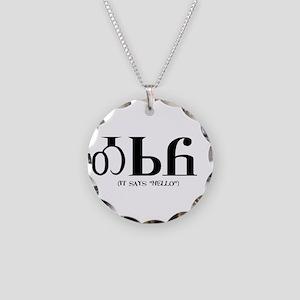 It says HelloBLACK Necklace Circle Charm