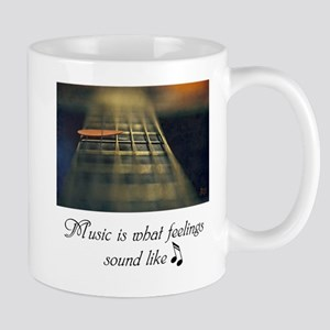 Music is what feelings sound like ~ Mugs