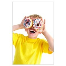 Boy playing with doughnuts Poster