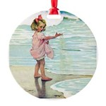 Child at the beach Round Ornament