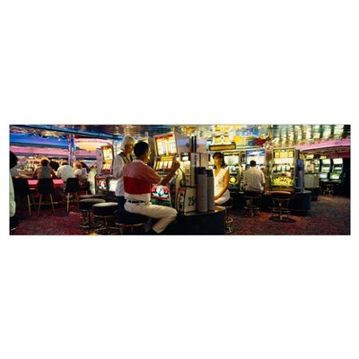 Group of people playing on slot machines in a casi Framed Print