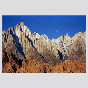 Rock formations on a mountain range, Moonset over