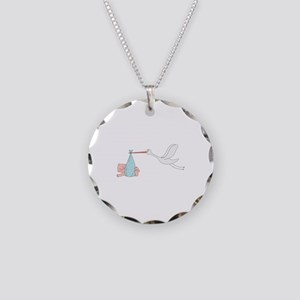 Cute stork carrying a newborn baby Necklace Circle