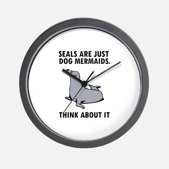 Seals are just dog mermaids. Wall Clock
