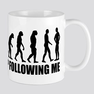 Stop following me evolution Mug