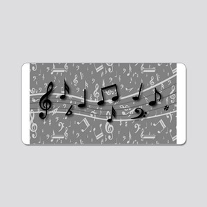 Black musical notes on a grey multi colored Alumin