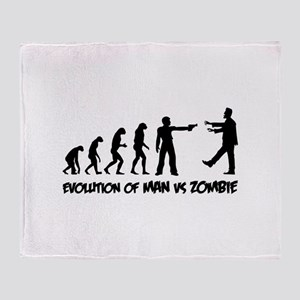 Evolution of man vs zombie Throw Blanket