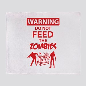 Warning do not feed the zombies Throw Blanket