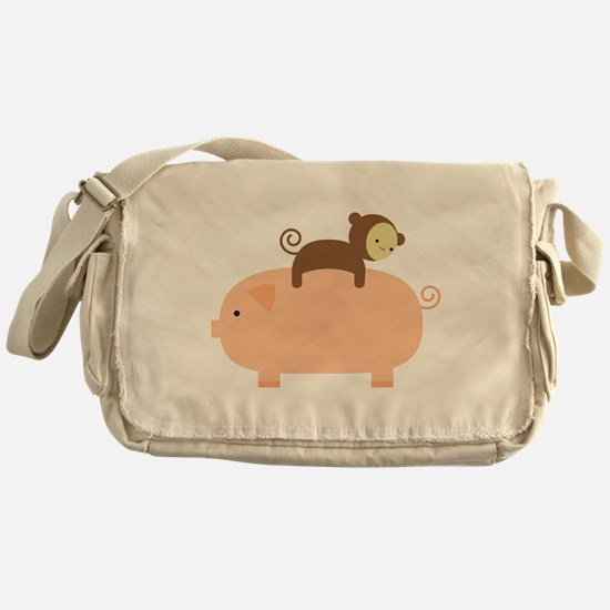 Baby Monkey Riding Backwards on a Pig Messenger Ba