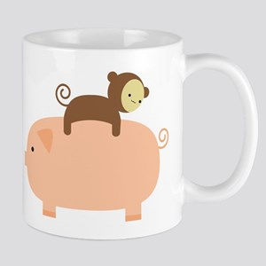 Baby Monkey Riding Backwards on a Pig Mug