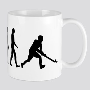 Field hockey evolution Mug