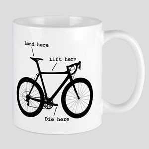 Lift here, land here, die here Mug