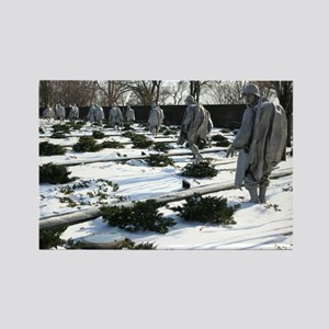 Korean war memorial veterans statues during snow R