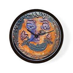 Moon face by Dana Graap. Wall Clock