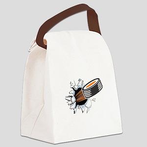 1hocky puck rip thru copy Canvas Lunch Bag