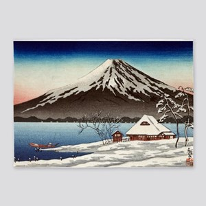 Winter landscape with small snow-covered building