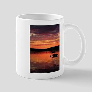 Solitary Sailboat at Sundown Mug