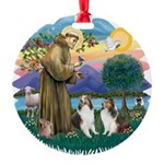 St.Francis (w) / 2 Shelties Round Ornament