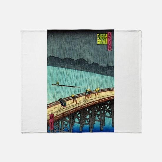 Pedestrians crossing a bridge during a rain storm