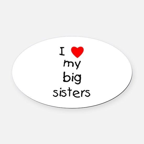 I Love My Big Sisters Oval Car Magnet