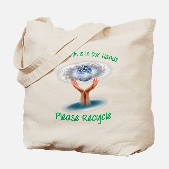 The earth is in our hands Tote Bag