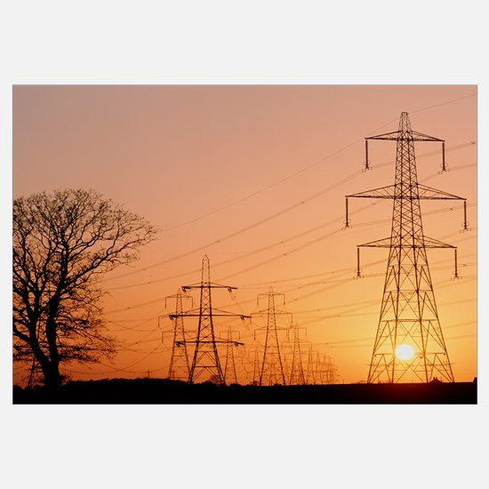 Pylons and power lines at sunset