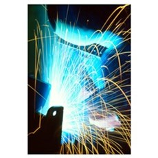 Sparks flying from an argon welder at work Poster