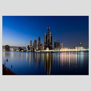 Buildings in a city lit up at dusk, Detroit River,