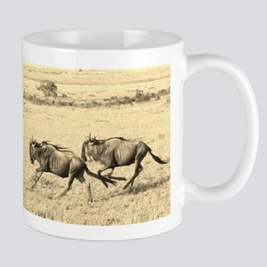 sepia wildebeest crossing kenya collection Mug