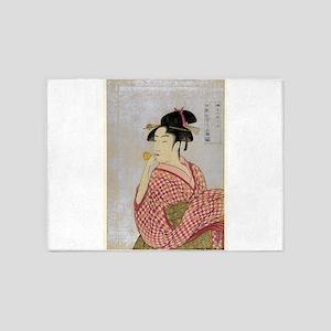 Young Lady Blowing On A Poppin - Utamaro Kitagawa