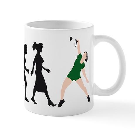 evolution female badminton player Mug