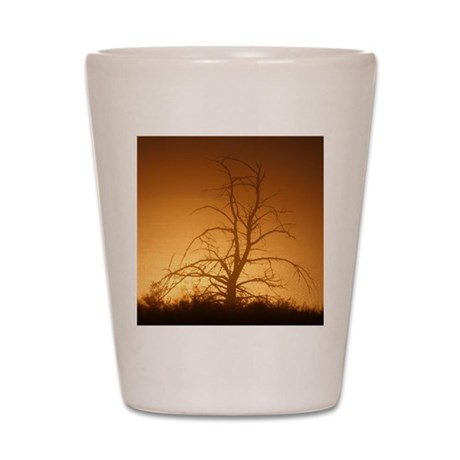 Tree over water Shot Glass