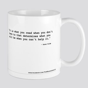 """It's what you read"" Wilde Mug"