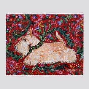 Wheaten Scottish Terrier on Red Throw Blanket
