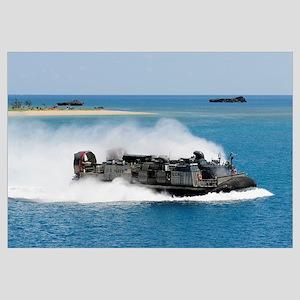 A landing craft air cushion approaches the well de