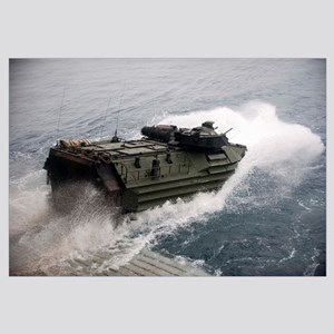 An amphibious assault vehicle departs the well dec
