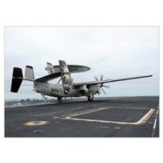 An E-2C Hawkeye launches off the flight deck of US Poster