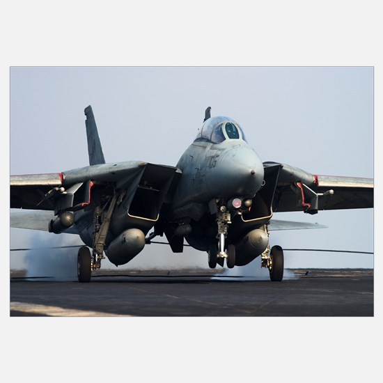 An F-14D Tomcat of VF-31 Tomcatters makes an arres