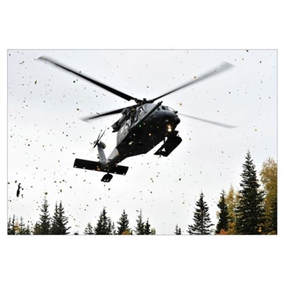 An HH-60G Pave Hawk helicopter prepares for landin Framed Print
