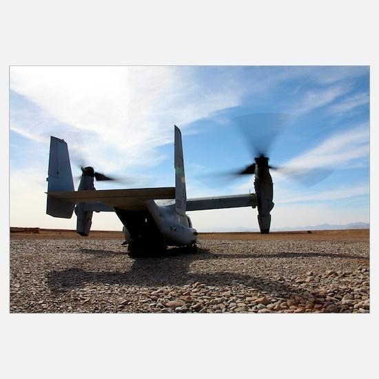 An MV-22 Osprey sits outside a forward operating b